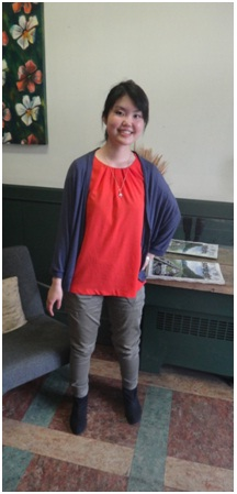 Momoko shows off her bright orange shirt, eye-catching in the midst of her other subdued, earthy style choices.