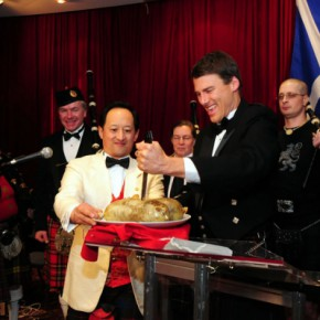 Todd Wong (left) gave Mayor Gregor Robertson a stab at the haggis at 2009 Gung Haggis Fat Choy dinner, an annual celebration of both Robbie Burns Day and Chinese New Year. Photo credit: The Georgia Straight