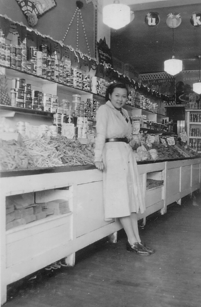 Jean Lumb at her fruit store, 1938, on Bathurst Street in Toronto